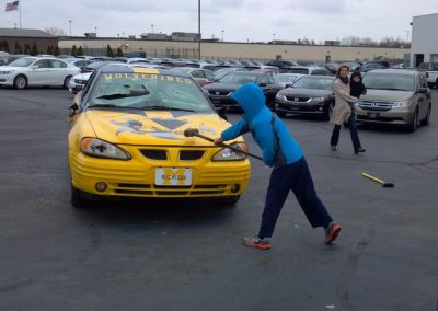 """FireFighters 4 Kids Toy Drive Bashing the """"M""""word car"""